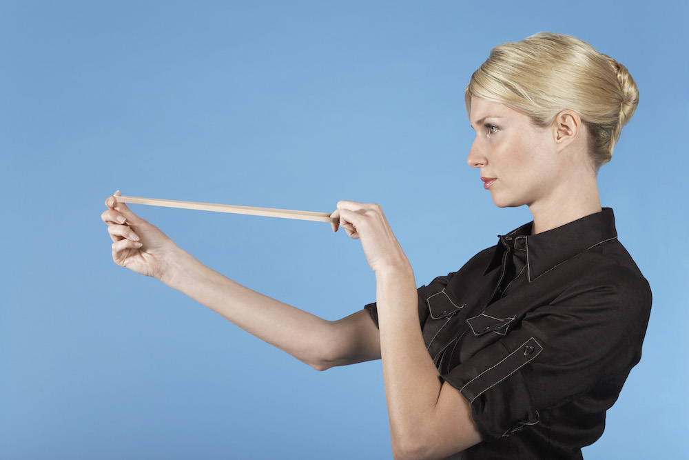 a woman stretching a rubber band
