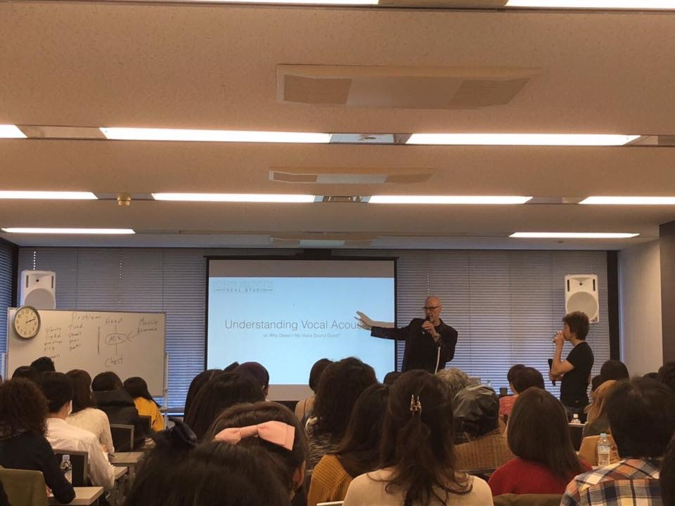 John henny lecturing in Japan