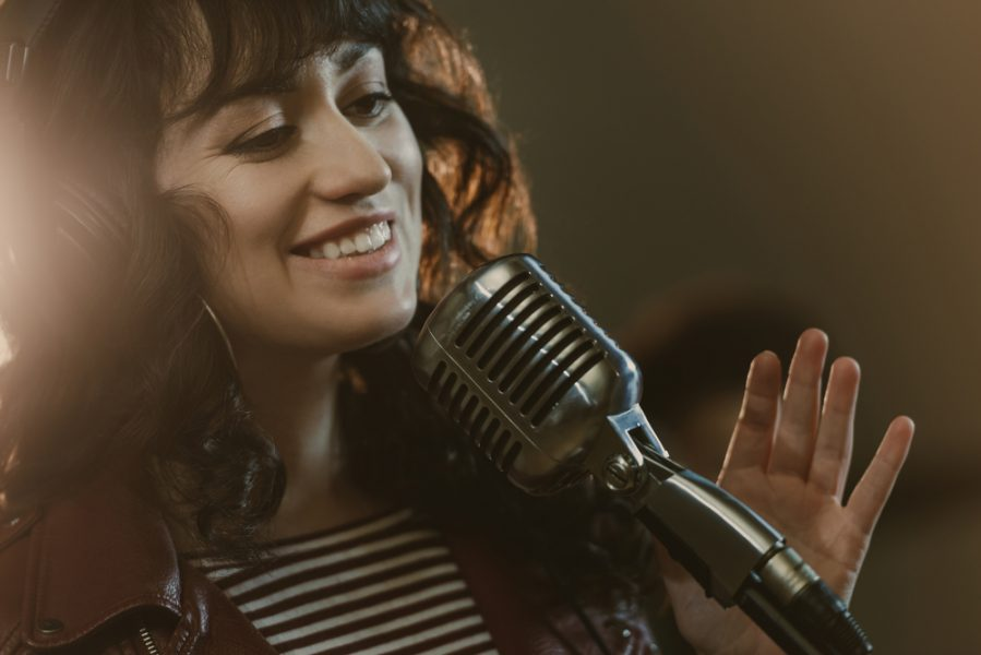 a singer smiling while singing